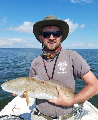 CJ with his first Louisiana Redfish