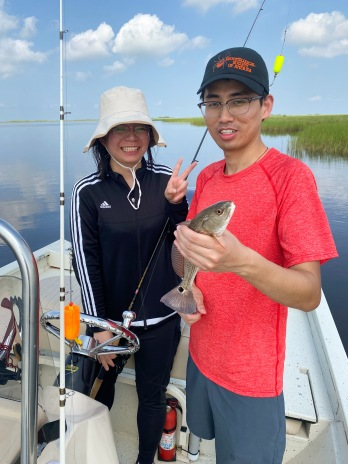 PhD students of the Swale Lab with a redfish