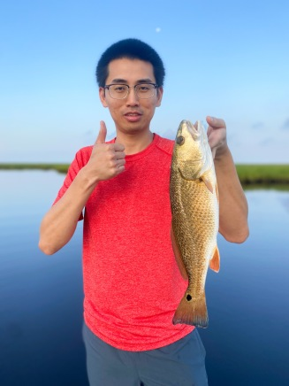 Zhilin Li with his first redfish from the Louisiana Marsh